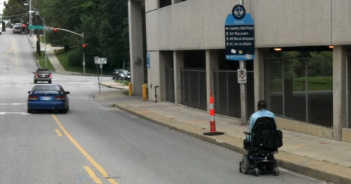 Photo of wheelchair in the street
