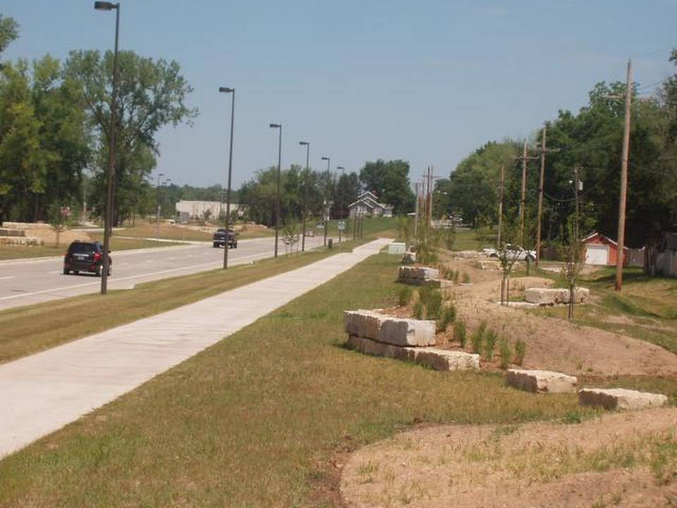 New Chouteau Parkway with bike lanes and trail